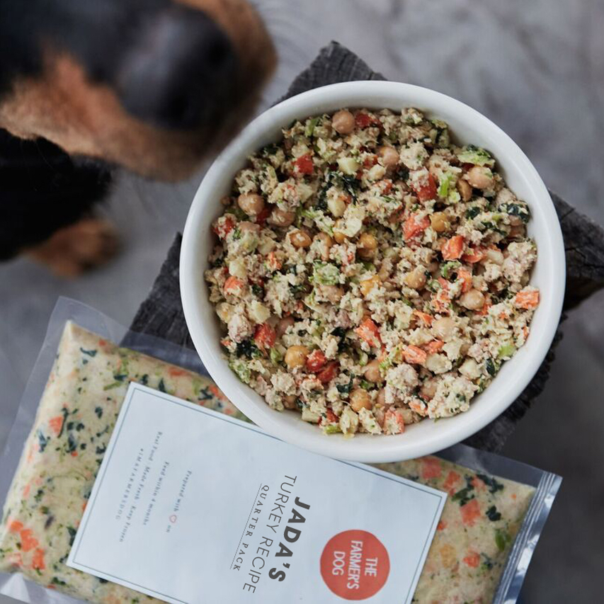 Copulsky's dog Jada shows off the turkey blend packaged just for her